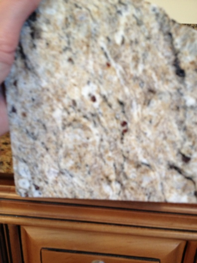 Granite #1 A Beigey Creamy Granite with small speckles of dark brown and red.